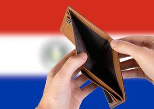 Empty Wallet with Flag of Paraguay. Recession and Financial Crisis to come with more debt and federal budget deficit?