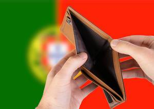 Empty Wallet with Flag of Portugal. Recession and Financial Crisis to come with more debt and federal budget deficit?