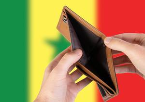 Empty Wallet with Flag of Senegal. Recession and Financial Crisis to come with more debt and federal budget deficit?