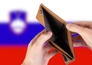 Empty Wallet with Flag of Slovenia. Recession and Financial Crisis to come with more debt and federal budget deficit?