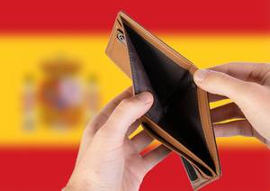 Empty Wallet with Flag of Spain. Recession and Financial Crisis to come with more debt and federal budget deficit?