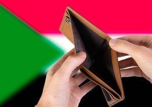 Empty Wallet with Flag of Sudan. Recession and Financial Crisis to come with more debt and federal budget deficit?