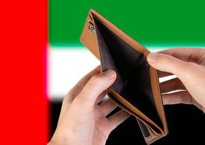 Empty Wallet with Flag of United Arab Emirates. Recession and Financial Crisis to come with more debt and federal budget deficit?