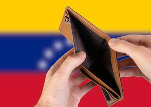 Empty Wallet with Flag of Venezuela. Recession and Financial Crisis to come with more debt and federal budget deficit?