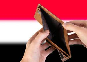 Empty Wallet with Flag of Yemen. Recession and Financial Crisis to come with more debt and federal budget deficit?