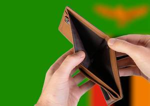Empty Wallet with Flag of Zambia. Recession and Financial Crisis to come with more debt and federal budget deficit?
