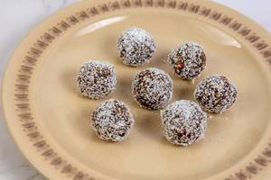 Energy Balls with Dates and Peanut Butter in the Coconut