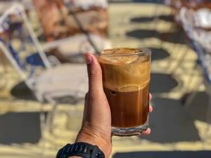 Enjoying Freddo Cappuccino on a warm summer day