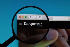 Enterpreneur logo under magnifying glass