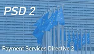 """Europäische Flaggen mit dem Text zur Zahlungsdiensterichtlinie """"PSD 2 -  Payment Services Directive 2"""""""