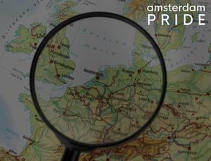 Europe under magnifying glasses with the marked destination Amsterdam on a map, next to the title Amsterdam Pride, an annual weekend long festival