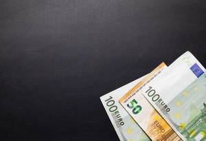Euros on black background