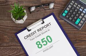 Excellent credit score report of 850 on office table
