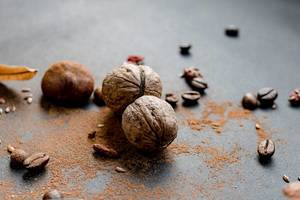 Fall compositon- walnuts, coffee beans, leaves and cinnamon