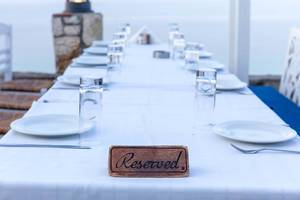 Family dinner: reserved table with white tablecloth in a restaurant