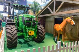 Farm tractor and horse at Farming Simulator 19 booth