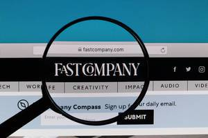 Fast Company logo under magnifying glass