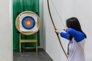 Female archer taking aim