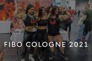 """Female bodybuilder with Wings of Strength shirts show their muscles, with the picture title """"Fibo Cologne 2021"""""""