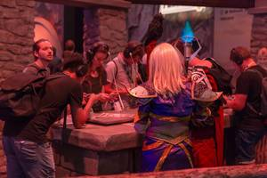 Female cosplayer clad as magician at Torchlight Frontiers booth
