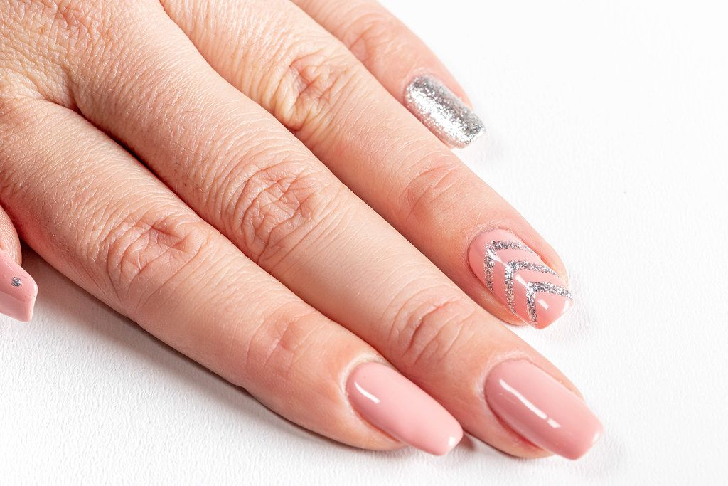 Female hand with long nails and manicure