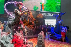 Figures of different game characters at Darksiders III booth