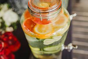 Filled Fruit Water Glass Botle With Oranges and Limes