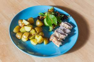 Fillet of pork with potatoes and corn salad