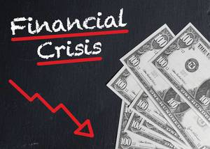 Financial crisis trend arrow goes down, next to American money