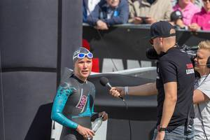 Finnish professional athlete Kaisa Sali before the start of the Ironman triathlon in Lahti, gives an interview in her wetsuit