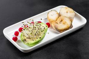 Fish slices with avocado, micro-green onions and cranberries (Flip 2019)