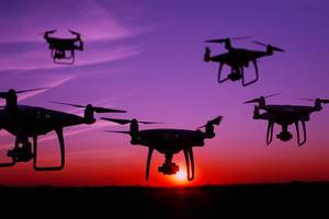 Five drones in the sky at sunset (Flip 2019)