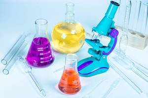 Flasks with reagents, microscope and laboratory glassware (Flip 2020)
