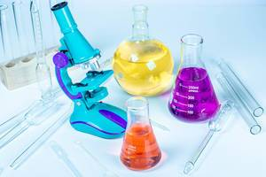 Flasks with reagents, microscope and laboratory glassware