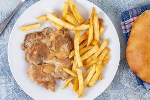 Flat lay above Chicken Drumstic with French Fries and bread (Flip 2019)