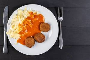 Flat Lay above Chicken Meat Meatballs with Tomato Sauce and Pasta (Flip 2019)
