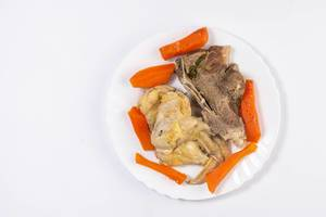 Flat lay above cooked Beef and Chicken meat with carrot