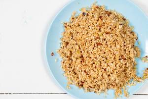 Flat lay above Cooked Integral Rice in the blue plate