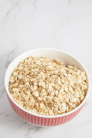 Flat lay above Dry Oatmeal in the bowl