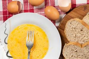 Flat lay above Eggs in the plate and Bread slices