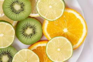 Flat lay above sliced Orange Kiwi Citrus Lemon (Flip 2019)