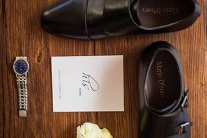 Flat lay photo of groom details