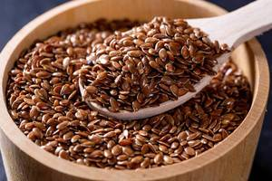 Flax seeds in a wooden bowl