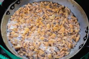 Flour tempura deep fried in a pan