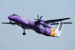 Flybe airplane, ATR aircraft up in the sky