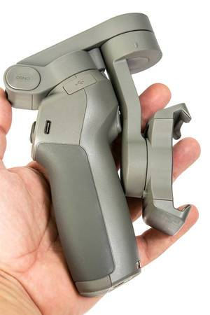 Folded DJI Osmo Mobile 3 phone gimbal in the hand
