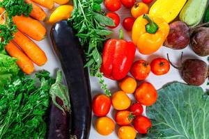 Food background with fresh vegetables and greens