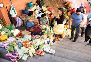Food Market on Stairs with Sellers and Visitors in Guatemala