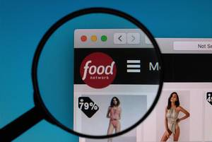 Food Network logo under magnifying glass
