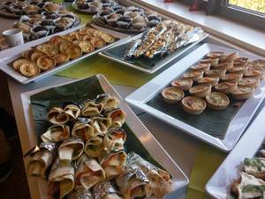 Food Photo of Buffet with Wraps, Mini Vegetable Pies and Muffins